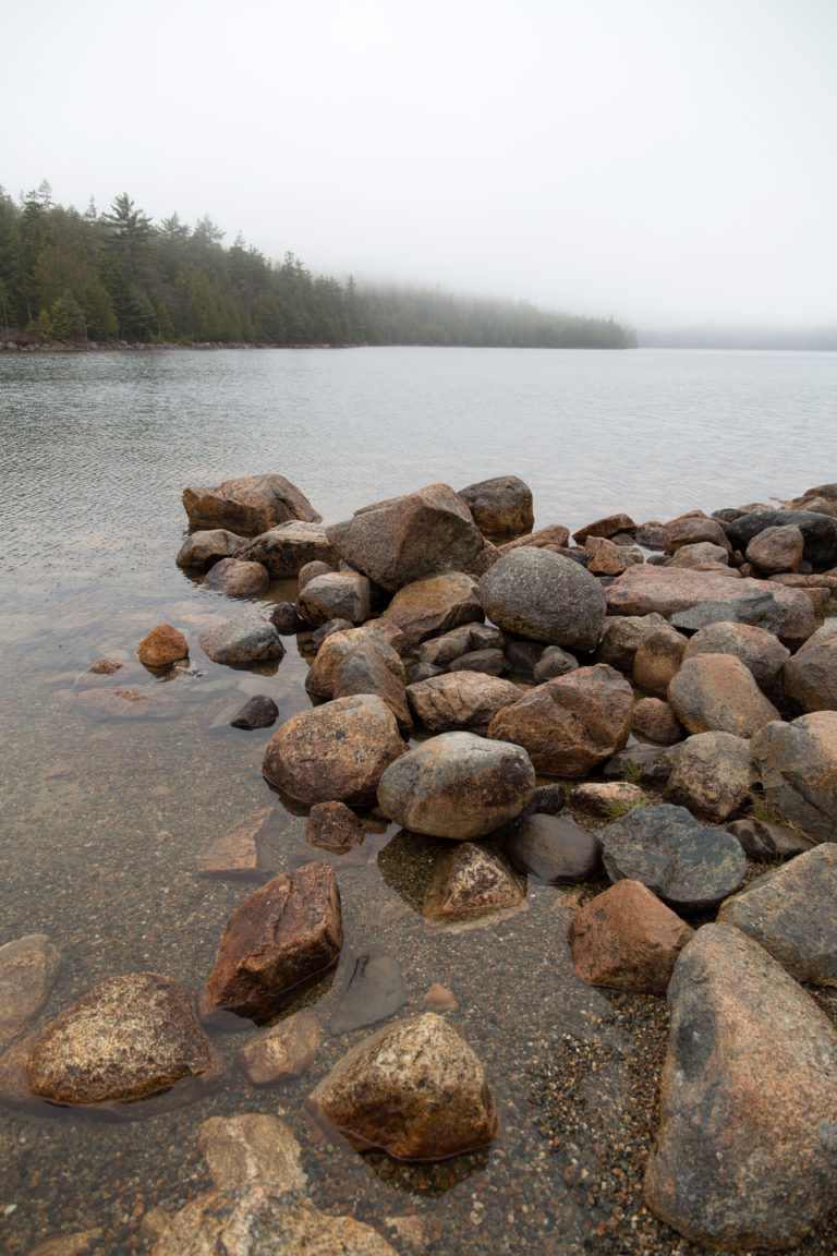 Pile of Rocks in Foggy Lake