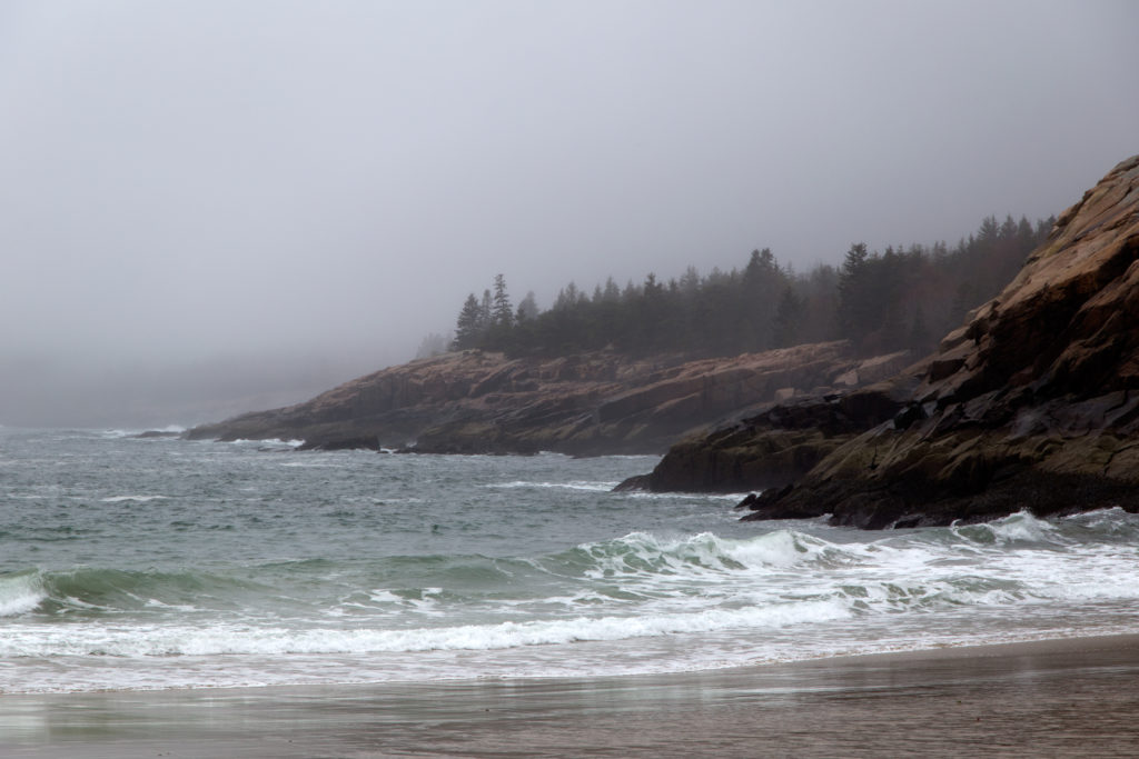 Waves Rolling onto the Beach and Rocky Shore