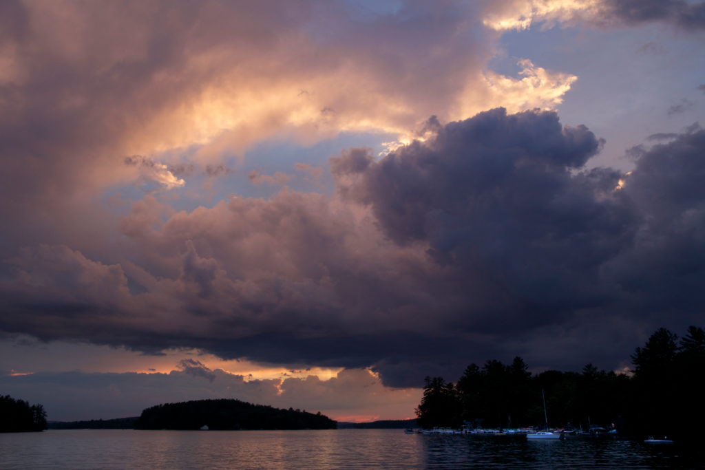 Stormy Sunset Clouds Over Water