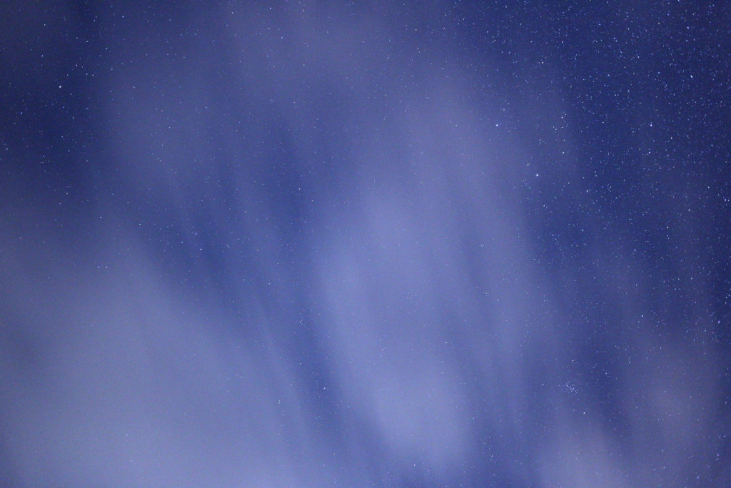 Stars Through Streaking Clouds