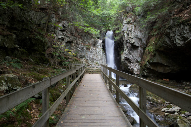 Wooden Walkway Leading to Waterfall