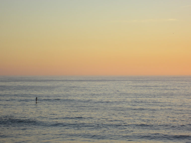 Person on the Ocean at Sunset