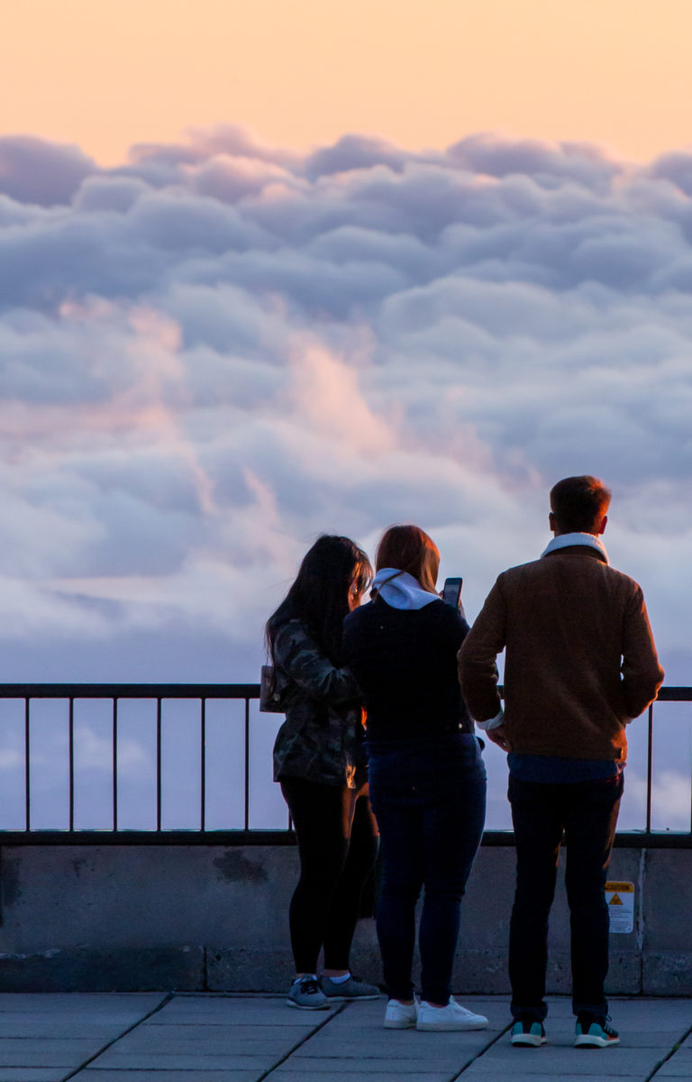 People Standing Above Clouds