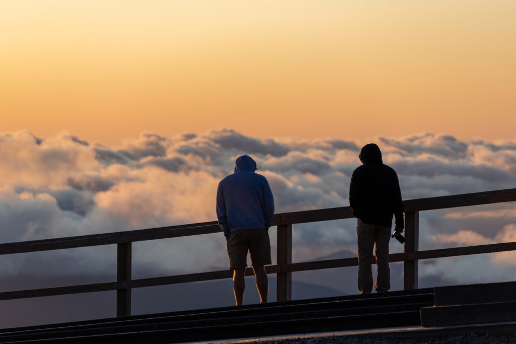 People Silhouettes Over Clouds