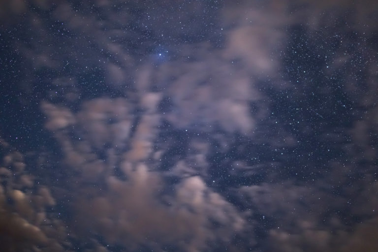 Stars Peeking Through Thin Pink Clouds
