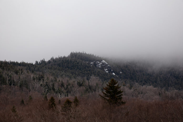 A Touch of Snow on Foggy Hillside