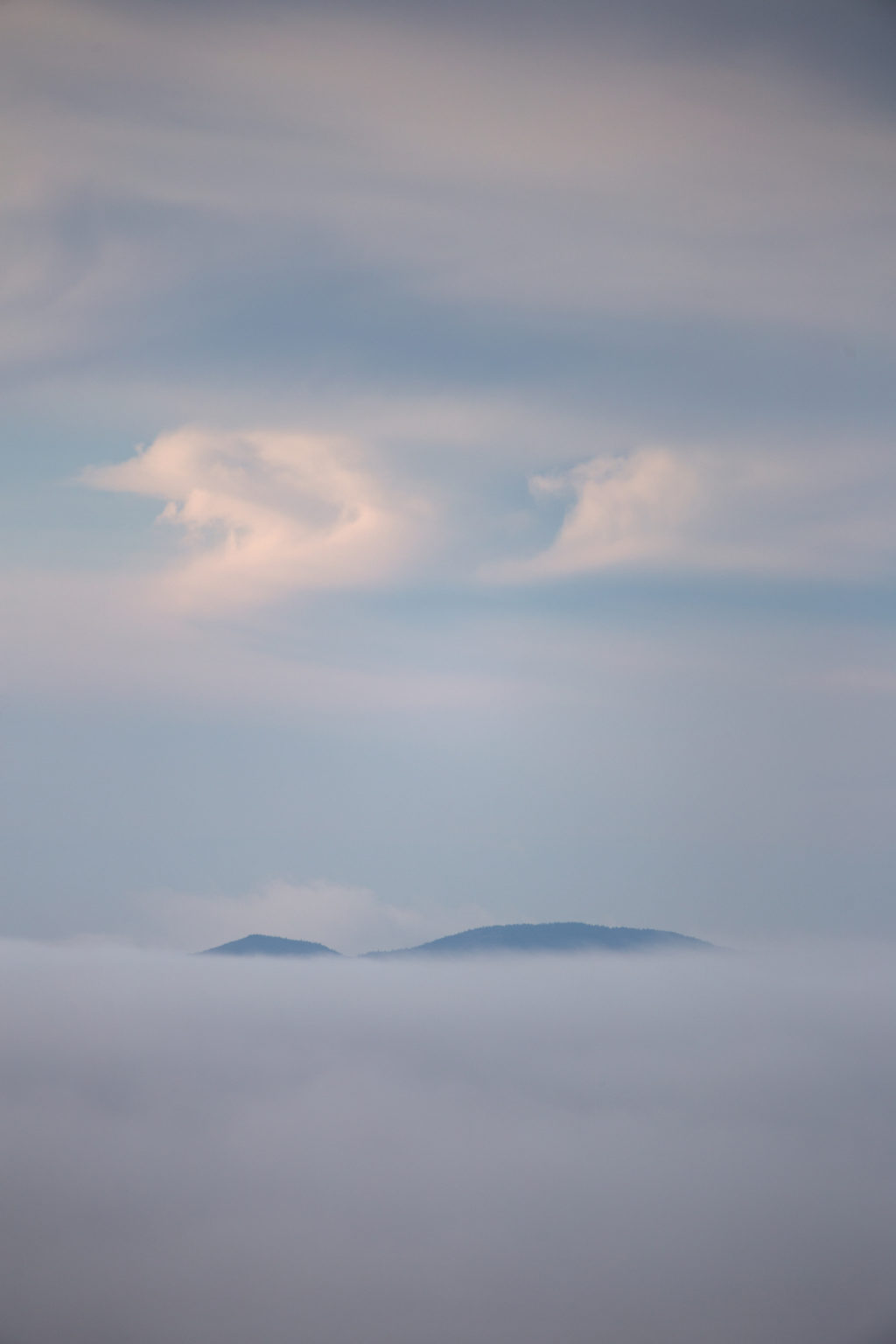 Mountaintop Peeking Over Thick Cloud Cover