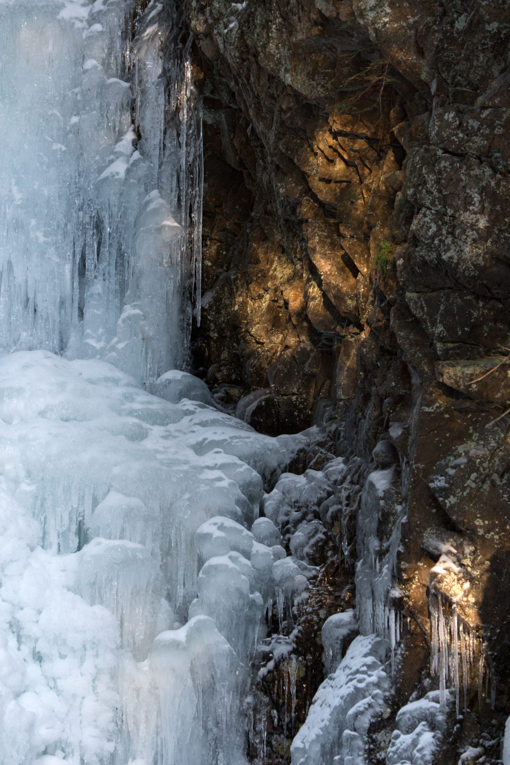 Frozen Waterfall on the Rocks