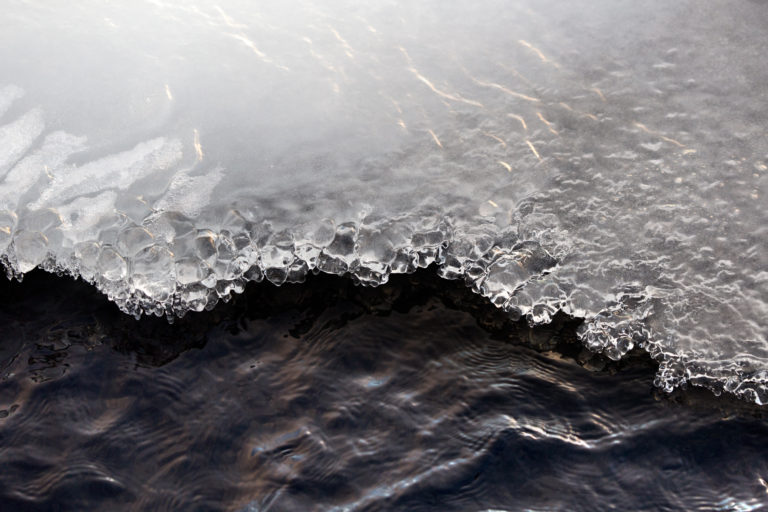 Ice Crystals on Water's Edge