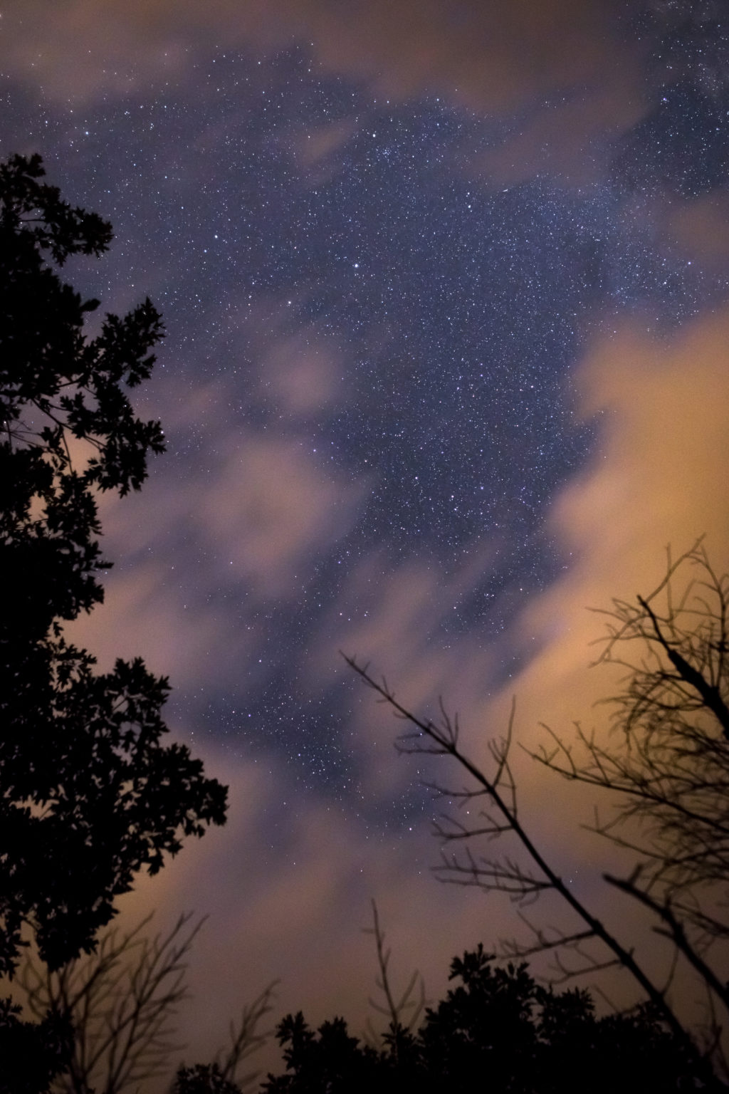 Blurry Clouds Moving Across Night Sky