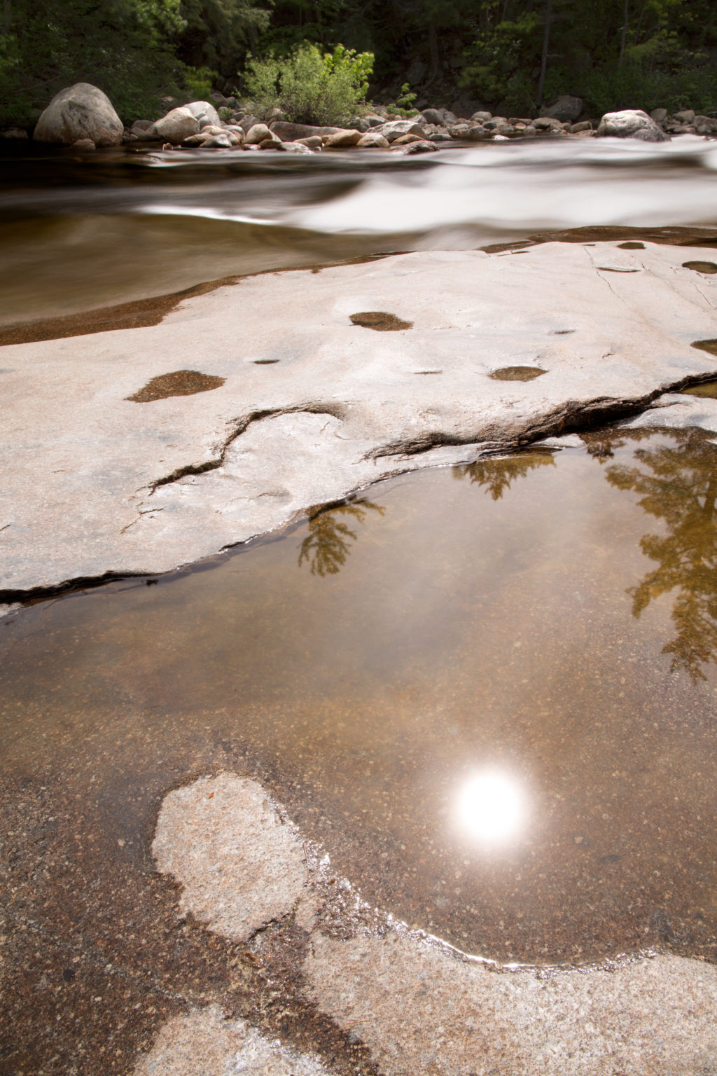 Sun Reflection in Small River Pool