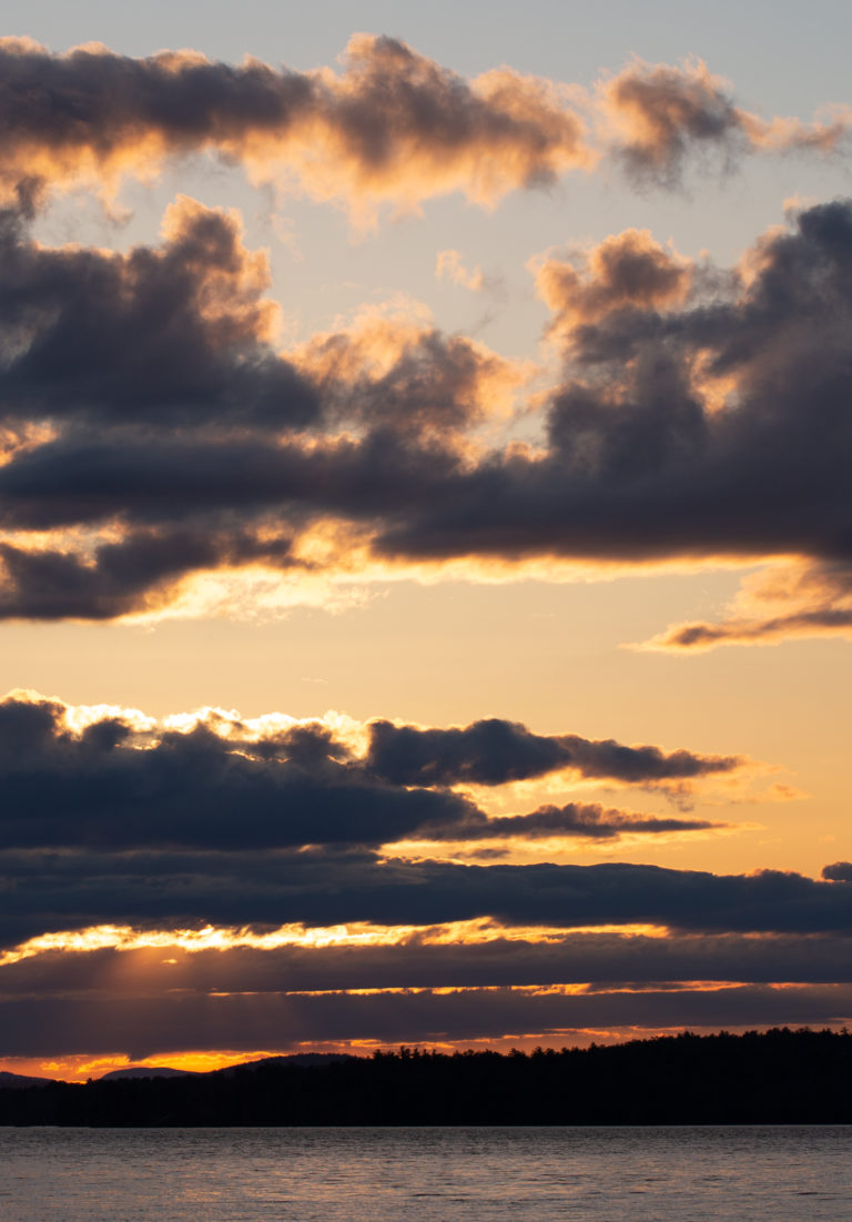 Cloud Silhouettes Against Golden Sunset Sky