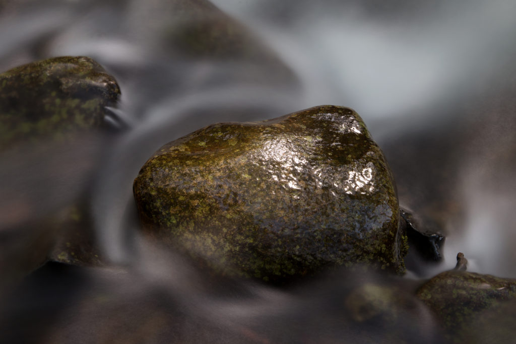 Swirling Water Around a Small Rock