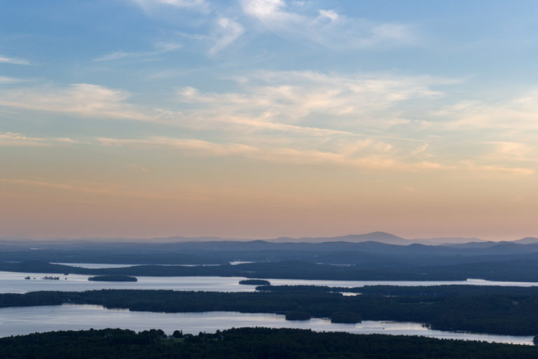 Hazy Sunset Over Lakes and Mountains