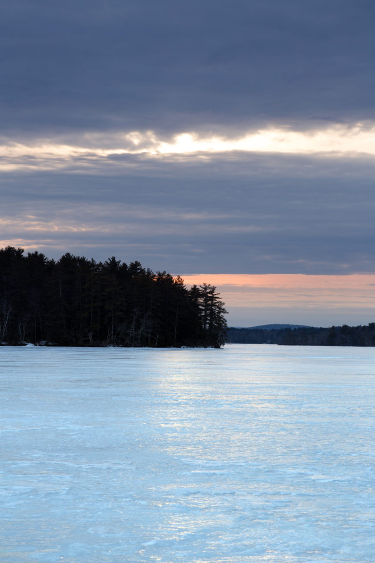 Frozen Lake with Land in View