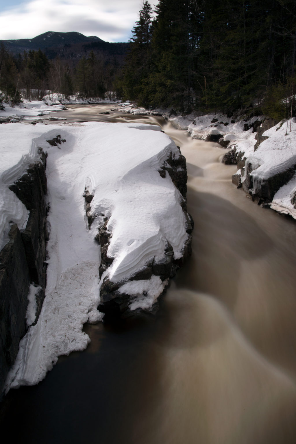 River Moving Through Snow-Covered Rocks