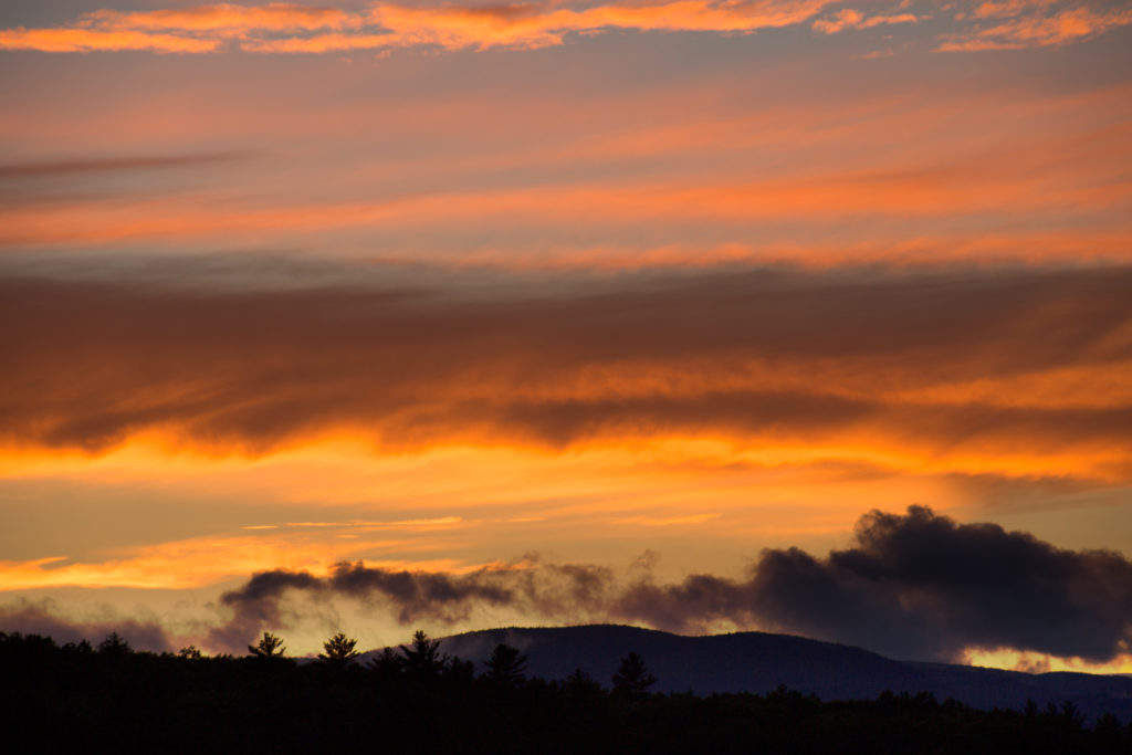 Fiery Clouds Over Mountain Silhouette